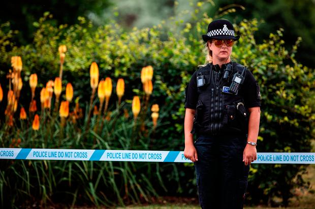 A police officer stands at a cordon at Queen Elizabeth Gardens, Salisbury, close to where Sergei and Yulia Skripal were found