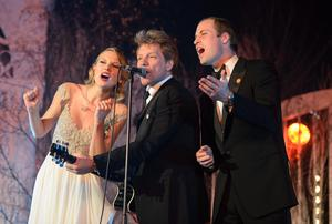 File photo dated 26/11/13 of the Duke of Cambridge (right) singing with Taylor Swift (left) and Jon Bon Jovi at the Centrepoint Gala Dinner at Kensington Palace, London Photo credit should read: Dominic Lipinski/PA Wire