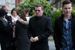 Billy McGUinness from Aslan (in glasses) arrives at the funeral of Tony Fenton.