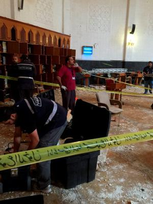 Police inspect the Imam Sadiq Mosque after a bomb explosion, in the Al Sawaber area of Kuwait City June 26, 2015. A suicide bomber blew himself up at the packed Shi'ite Muslim mosque in Kuwait city during Friday prayers, killing more than ten people, the governor of Kuwait City said. REUTERS/Kuwait News AgencyÄ®ATTENTION EDITORS - THIS IMAGE WAS PROVIDED BY A THIRD PARTY.  NO SALES. NO ARCHIVES.  THIS PICTURE IS DISTRIBUTED EXACTLY AS RECEIVED BY REUTERS, AS A SERVICE TO CLIENTS. FOR EDITORIAL USE ONLY. NOT FOR SALE FOR MARKETING OR ADVERTISING CAMPAIGNS