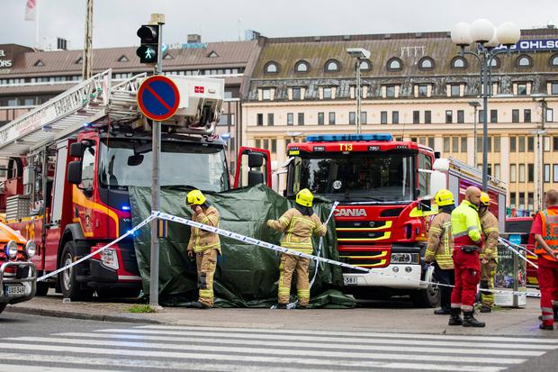 Rescue personnel cordon off the place where several people were stabbed at Turku Market Square in Finland on August 18. Picture: Reuters