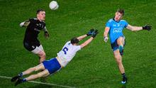 Seán Bugler of Dublin in action against Monaghan's Karl O'Connell and goalkeeper Rory Beggan