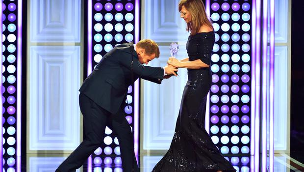 """BEVERLY HILLS, CA - MAY 31:  Actress Allison Janney (R) accepts the Best Supporting Actress award for """"Mom"""" from tv personality James Corden onstage at the 5th Annual Critics' Choice Television Awards at The Beverly Hilton Hotel on May 31, 2015 in Beverly Hills, California.  (Photo by Kevin Winter/Getty Images)"""