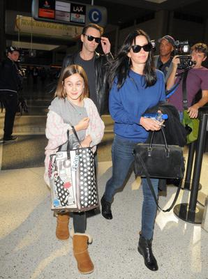 Courteney Cox, Johnny McDaid, and daughter Coco Arquette are seen at LAX airport