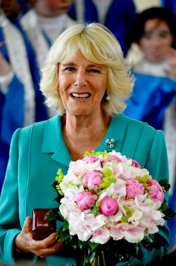 The Duchess of Cornwall met with students before taking part in the Suas literacy support programme  during her visit to the Claddagh National School in Galway on the first day of her Royal visit to the Republic of Ireland. PRESS ASSOCIATION Photo. Picture date: Tuesday May 19, 2015. See PA story ROYAL Ireland. Photo credit should read: Jeff J Mitchell/PA Wire