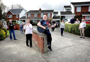 Sing-song: Gerry Dempsey, who is taking the time to play his guitar and sing for his elderly neighbours, pictured with some of those neighbours at their home in Whitecliff in Rathfarnham. Photo: Frank McGrath