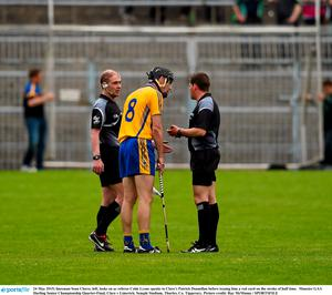 24 May 2015; linesman Sean Cleere, left, looks on as referee Colm Lyons speaks to Clare's Patrick Donnellan before issuing him a red card on the stroke of half time.  Munster GAA Hurling Senior Championship Quarter-Final, Clare v Limerick. Semple Stadium, Thurles, Co. Tipperary. Picture credit: Ray McManus / SPORTSFILE