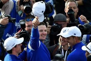 Team Europe players Rory McIlroy (L) and Justin Rose (C) celebrate teammate Jamie Donaldson winning his match against U.S. player Keegan Bradley    to retain the Ryder Cup for Europe on the 15th green during their 40th Ryder Cup singles golf match at Gleneagles in Scotland September 28, 2014.   REUTERS/Toby Melville (BRITAIN  - Tags: SPORT GOLF)