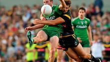 Pearse Hanley is tackled by Jobe Watson in the Rules Test, in which the Australians showcased their superior kicking ability. Ray McManus / SPORTSFILE