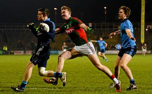 Stephen Cluxton, Dublin, supported by team-mate Michael Fitzsimons, in action against Danny Kirby, Mayo.