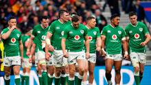 Ireland players react after conceding their side's third try against England