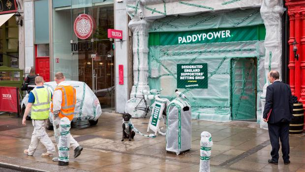 """NO FEE FOR 1ST REPRO With Ireland and the old enemy set to clash on these shores for the first time since English hooligans tore Lansdowne Road to pieces, Paddy Power have moved to protect their closest shop to the ground by Yob-Proofing the exterior of their Baggot St branch. The extraordinary step has seen the bookmaker cover the entire shop with bubble wrap in hope of avoiding any damage that may come from violent yobs, knobs and hooligans who may infiltrate the Three Lions' well-meaning travelling support.""""   Paddy Power, a spokesperson for Paddy Power, said """"It's not that I'm anti-English. Some of my best friends are English. But you can't deny they have sent us some bad eggs over time. Cromwell for example. He would have smashed up The Aviva if it was around in the 1600s. Us Irish wage war in a more subtle way. We just pillage their players and send them Louis Walsh. Pic Paul Sharp/SHARPPIX"""