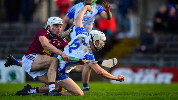 Jack Fagan of Waterford is fouled by Adam Ennis of Westmeath for a penalty. Photo by Piaras Ó Mídheach/Sportsfile