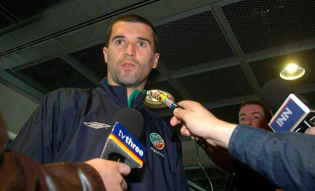 Roy Keane is interviewed by journalists at Dublin Airport as Ireland departed for the World Cup on May 17, 2002. Photo: David Maher/SPORTSFILE