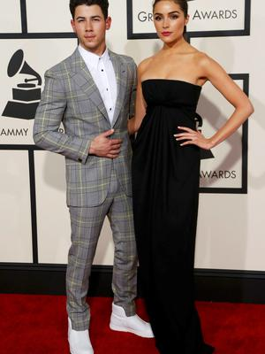 Singer Nick Jonas and Olivia Culpo arrive at the 57th annual Grammy Awards in Los Angeles, California