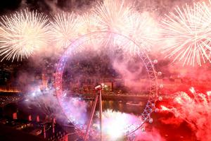 Fireworks explode around the London Eye during the New Year celebrations in central London just after midnight on January 1, 2016. AFP PHOTO / JUSTIN TALLISJUSTIN TALLIS/AFP/Getty Images