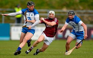 Galway's Andy Smith tries to squeeze through the gap between Waterford's Kevin Moran, left, and Pauric Mahony at Walsh Park
