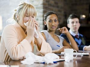 What should I do if one of the near colleagues is coughing and sneezing?