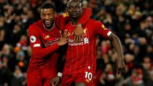Liverpool's Sadio Mane celebrates scoring a goal with Georginio Wijnaldum