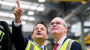 Making his point: Leo Varadkar (left) with Simon Coveney at the Combilift factory in Annahagh, Co Monaghan. Photo: Liam McBurney/PA Wire