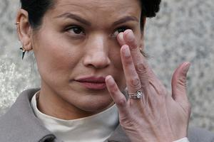 Emotional day: Tarale Wulff wipes her eye before speaking to the media after the sentencing. Photo: REUTERS/Carlo Allegri