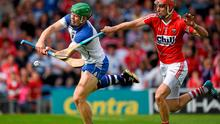 Jamie Barron is hooked by Cork full back Stephen McDonnell on his way to scoring Waterford's third goal