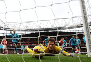 Stoke's Asmir Begovic fails to stop the ball crossing the line as Alexis Sanchez scores Arsenal's third goal from a freekick