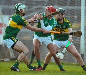 Limerick's Barry Nash in action against Paud Costello, left, Billy Lyons of Kerry. Photo: Diarmuid Greene/Sportsfile