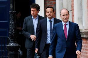 Green leader Eamon Ryan, Fine Gael leader Leo                   Varadkar and Taoiseach Micheál Martin. Photo: Julien                   Behal/PA Wire