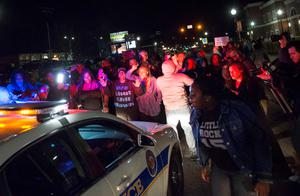 Protestors block a police vehicle from entering the City of Ferguson Police Department and Municipal Court parking lot in Ferguson Missouri   REUTERS/Kate Munsch
