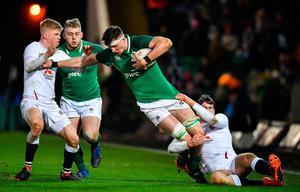 Thomas Ahern of Ireland is tackled by George Barton, left, and Tom Roebuck during the Six Nations U20 Rugby Championship match at Franklins Gardens in Northampton, England. Photo: Brendan Moran/Sportsfile
