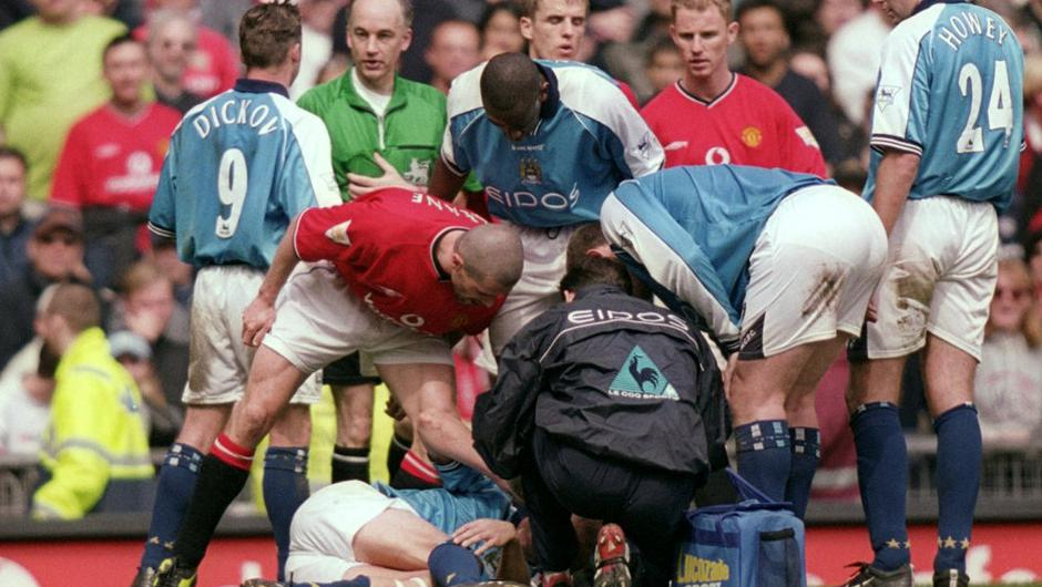 Roy Keane rages at Alf Inge Haaland as their rivalry reached boiling point in 2001. 'The ball was there (I think). Take that, you c***,' Keane later wrote. Photo: Gary M Prior/Allsport