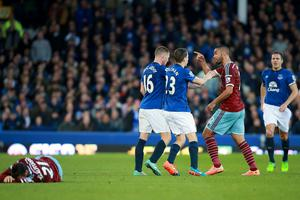 Tempers flare between the two sides after Everton's James McCarthy (centre) brings down West Ham United's Morgan Amalfitano (floor) to earn himself a yellow card. Photo credit: Peter Byrne/PA Wire