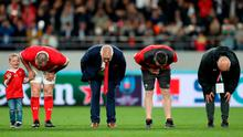 Wales' Head Coach Warren Gatland (second left) bows to the fans after the final whistle of the 2019 Rugby World Cup bronze final match at Tokyo Stadium. Photo credit: David Davies/PA Wire.