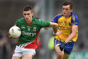 Mayo goalscorer Cian Hanley breaks away fromRoscommon's Brian Stack during the Connacht MFC final at MacHale Park. Photo: David Maher / SPORTSFILE