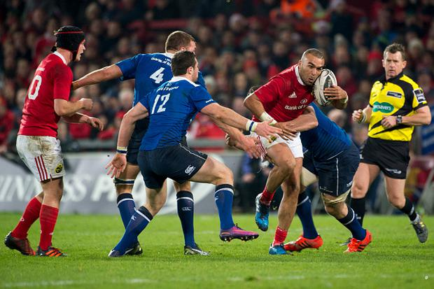 Simon Zebo of Munster and Robbie Henshaw and Tadgh Furlong during the Guinness PRO12 Round 11 match between Munster Rugby and Leinster Rugby at Thomond Park Stadium in Limerick, Ireland on December 26, 2016 (Photo by Andrew Surma/NurPhoto via Getty Images)