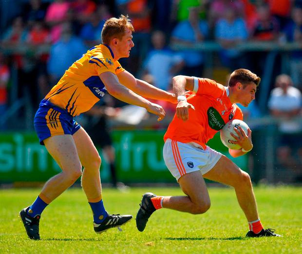 Gregory McCabe of Armagh in action against Pearse Lillis of Clare. Photo: Seb Daly/Sportsfile