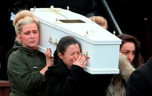 March 24, 2016: A devastated Louise James carries the coffin of one of her sons at the church in Derry as mourners attended the Buncrana pier tragedy funeral. Louise James lost her long-term partner Sean McGrotty, her mother Ruth Daniels, her sister Jodi-Lee (15) and their children, Mark (12), Evan (8) in the incident. Baby Rioghnach-Ann was saved by a heroic passery-by. (Brian Lawless/PA Wire)
