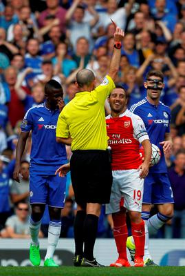Arsenal's Spanish midfielder Santi Cazorla is shown a red card by referee Mike Dean