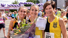 Aoibhe Richardson, centre, with her mother Niamh and her sister Grace after winning the 2019 Vhi Women's Mini Marathon. Photo: Sportsfile