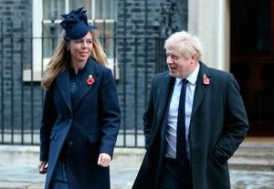 Prime Minister Boris Johnson and Carrie Symonds in Downing Street arriving for the Remembrance Sunday service at the Cenotaph memorial in Whitehall, central London