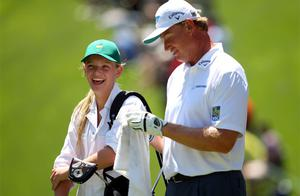 Ernie Els of South Africa and his daughter, Samantha, walk during the Par 3 Contest. Photo: Reuters