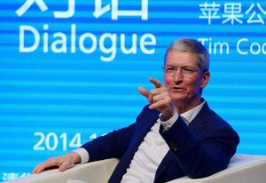 "Apple CEO Tim Cook says he has always been ""proud to be gay"" and that it is ""among the greatest gifts God has given me"" (REUTERS/China Daily)"