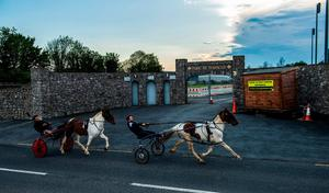 Out of Stride: Danny and Paddy Harty from Dungarvan gallop past a closed Fraher Field on Saturday when Waterford should have been playing Limerick in this year's Munster SFC opener. Photo: Ramsey Cardy/Sportsfile