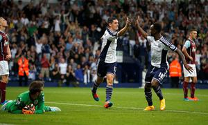 "West Bromwich Albion's Graham Dorrans (C) celebrates with Saido Berahino after scoring his team's fourth goal during their English Premier League soccer match against Burnley at The Hawthorns in West Bromwich, central England, September 28, 2014. REUTERS/Andrew Yates (BRITAIN - Tags: SPORT SOCCER) NO USE WITH UNAUTHORIZED AUDIO, VIDEO, DATA, FIXTURE LISTS, CLUB/LEAGUE LOGOS OR ""LIVE"" SERVICES. ONLINE IN-MATCH USE LIMITED TO 45 IMAGES, NO VIDEO EMULATION. NO USE IN BETTING, GAMES OR SINGLE CLUB/LEAGUE/PLAYER PUBLICATIONS. FOR EDITORIAL USE ONLY. NOT FOR SALE FOR MARKETING OR ADVERTISING CAMPAIGNS"