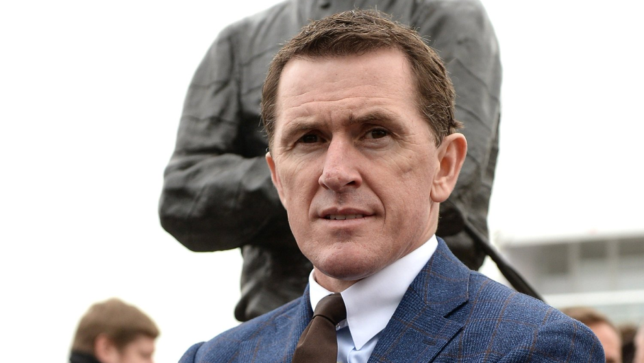 AP McCoy in front of his statue which was unveiled prior to the Cheltenham Racing Festival at Prestbury Park in 2017 - McCoy received a knighthood for his services to racing in 2016. Photo: Sportsfile