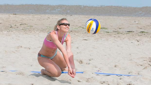 Winners: Kasia Sarnicka from Cabinteely during a beach volleyball tournament on Portmarnock beach. Photo: Gareth Chaney, Collins
