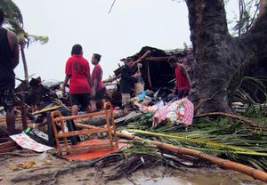 Local residents look through the remains of a small shelter in Port Vila, the capital city of the Pacific island nation of Vanuatu March 14, 2015. Winds of up to 250 kilometers an hour (155 mph) ripped metal roofs off houses and downed trees in Vanuatu   REUTERS/UNICEF Pacific/Handout via Reuters