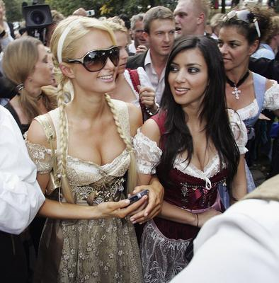 """MUNICH, GERMANY - SEPTEMBER 25: Socialite/actress Paris Hilton and her girlfrind Kim Kardashian attend the Octoberfest to promote the new canned sparkling wine """"Rich Prosecco"""" at the Munich Octoberfest on September 25, 2006 in Munich, Germany. (Photo by Thomas Niedermueller/Getty Images)"""