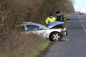 Garda forensic officers examine the car in which the two men who fled were travelling. Picture: Patrick Browne